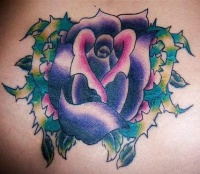 Purple rose with thorns tattoo