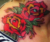 Colourful red roses tattoo