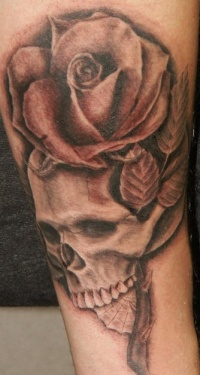 Realistic skull and rose tattoo